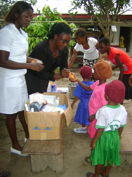 """Students receiving treatment as part of our deworming program. According to Robert Mundell, a Nobel prize winning economist at Columbia, """"Deworming is an overlooked intervention deserving of greater attention and resources. This simple, cheap investment can mean a child is healthier and spends more time in school."""""""