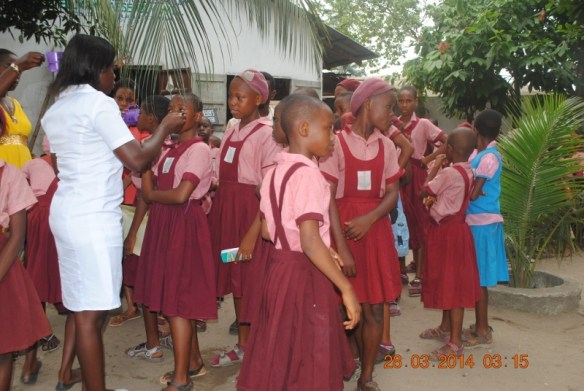 Bodo students receiving deworming treatment in March 2014.