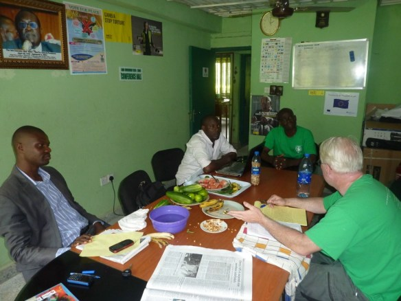 Our work often starts from small beginnings. Shown here from left to right are Dr. Nubari Nabie (health project coordinator), Zabbey Nenibarini (coordinator of our partner CEHRD), Rev. Moses Nyimale Lezor (Bodo school director) and Scott Pegg meeting at the CEHRD offices to discuss our planned health project in Bodo.