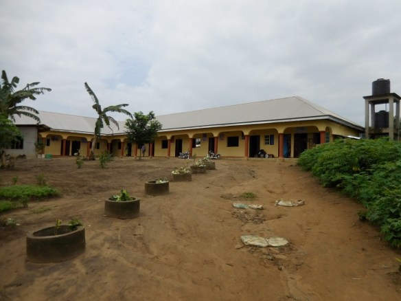 Our school buildings in Bori are now entirely finished.  Both buildings are shown here in July 2015 with the borehole tanks that provide the school's water on the far right of the picture.