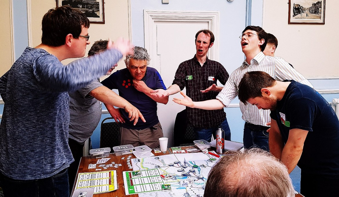 Players debating ferociously but all in good spirit at 1866 And All That - 7 Habits of Highly Effective Megagamers by BeckyBecky Blogs