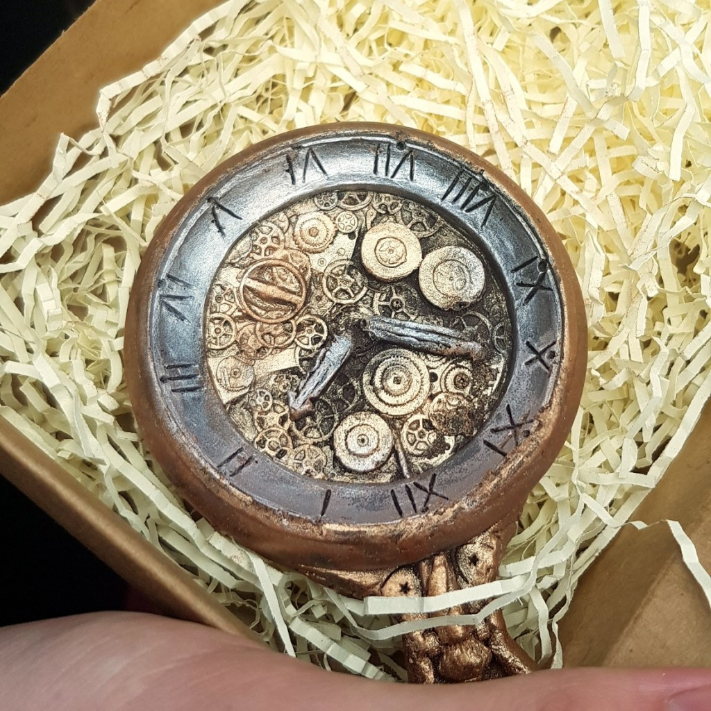 The chocolate pocket watch - 80 Days A Real World Experience review by BeckyBecky Blogs