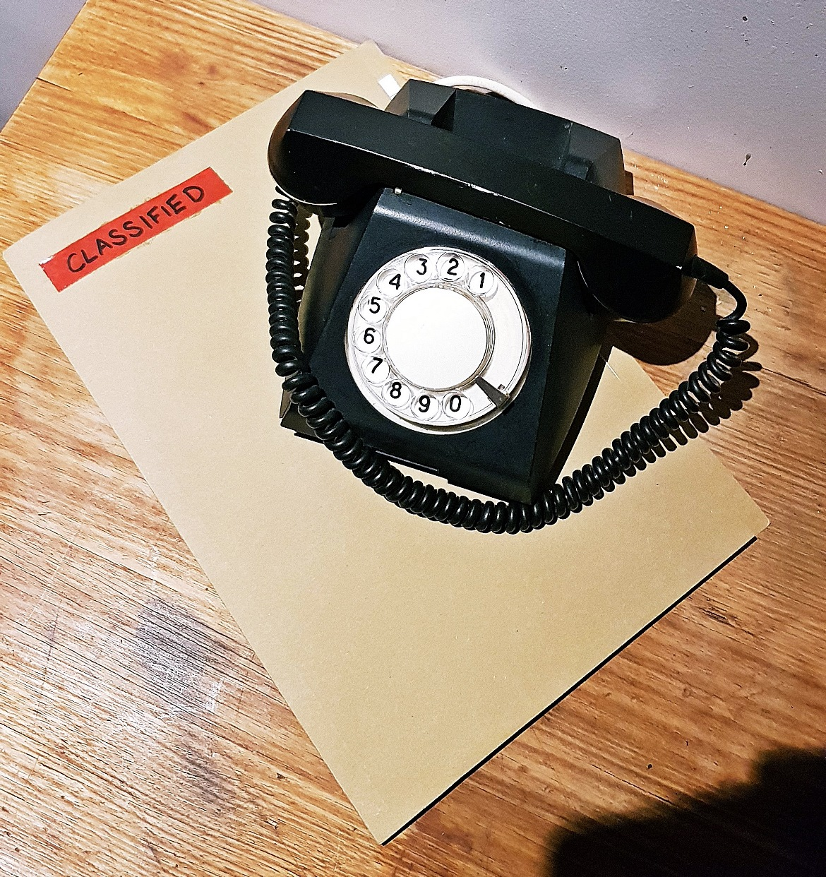 Phone and a confidential folder - Our Finest Hour, escape room by Escape Hunt Leeds, review by BeckyBecky Blogs