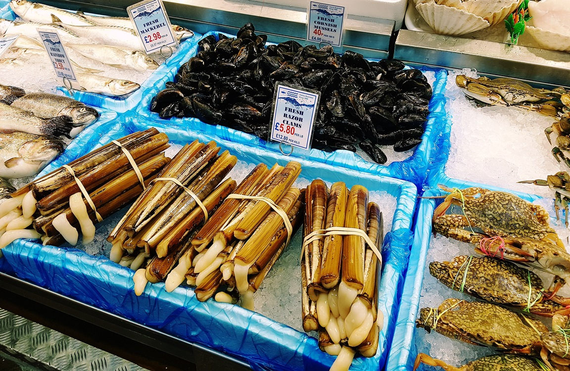 Mussels and razor clams on Arthur Welham's fishmongers in Kirkgate Market in Leeds
