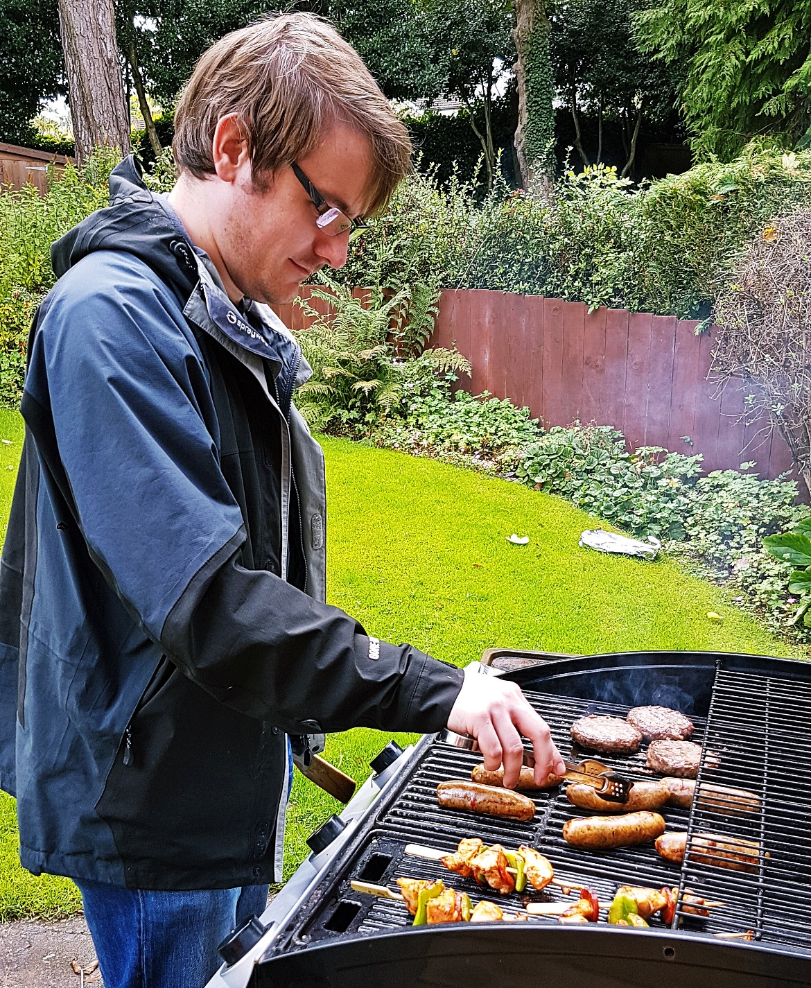 Tim cooking on the BBQ - September Monthly Recap by BeckyBecky Blogs