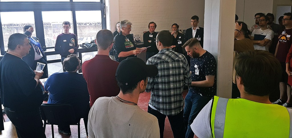 Jim Wallman giving the opening briefing - Urban Nightmare: State of Chaos, the Wide Area Megagame, After Action Report by BeckyBecky Blogs