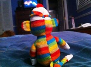 My sock monkey, Yolanda, has nothing to do with Jesus, really, but she's quite adorable an joyful (pictured here watching TV...probably LOST or Jimmy Fallon if I know Yolanda.).