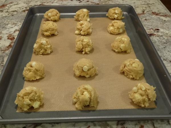 Rolled cookie dough placed on baking sheet