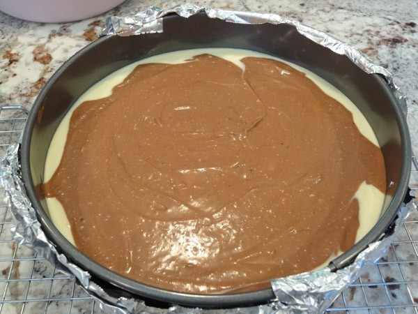 brownie and cheesecake batter added as next layer
