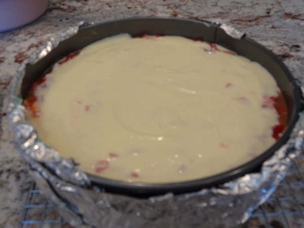 cream cheese layer added to springform pan
