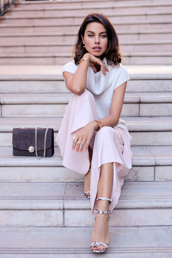 30 Chic Work Outfits to Wear this Summer: Fashion blogger 'Viva Luxury' wearing a white turtleneck tunic sweater, blush wide leg crop pants, snake print heeled sandals and a grey suede shoulder bag. Work outfits, summer work outfits, office wear, business casual, fashion, street style, womens fashion.