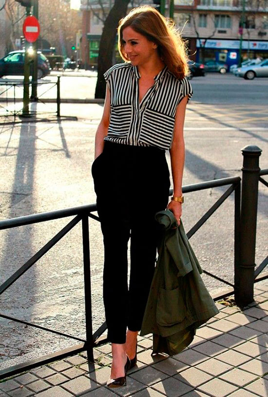 30 Chic Work Outfits to Wear this Summer: Woman wearing a black stripe blouse, black ankle pants, black patent heels and a military jacket. Work outfits, summer work outfits, office wear, business casual, fashion, street style, womens fashion, spring work outfits, fall work outfits.