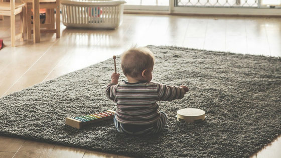 baby-playing-on-floor