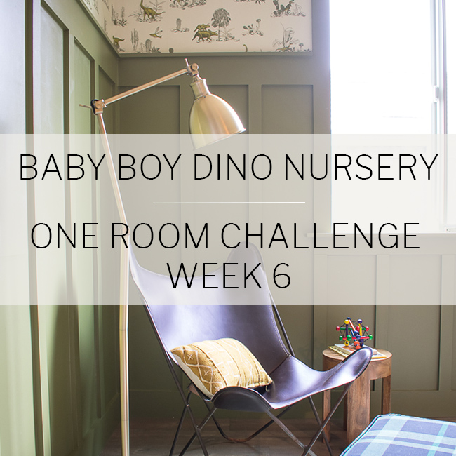 Baby boy dinosaur themed nursery with wall paper, wood paneling, leather chair, and olive green by Beebout Design.