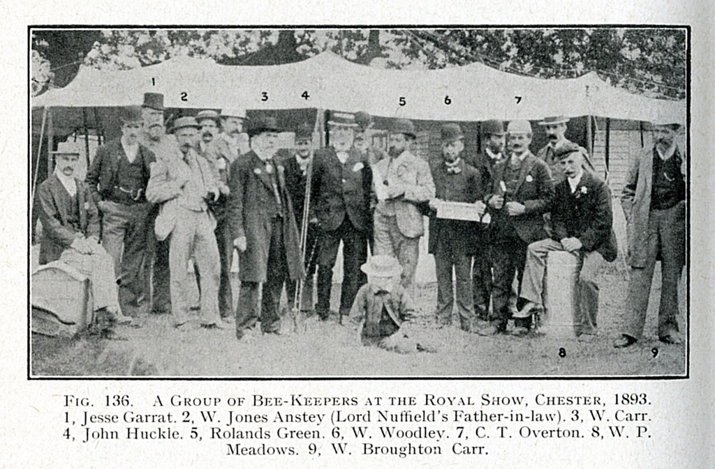 William Woodley (Beekeeper) with fellow competitors at the Royal Show, Chester in 1893. William Woodley is holding his winning frame of honeycomb. In the photograph is the famous William Broughton Car who invented the WBC hive.  William Woodley (Beekeeper)
