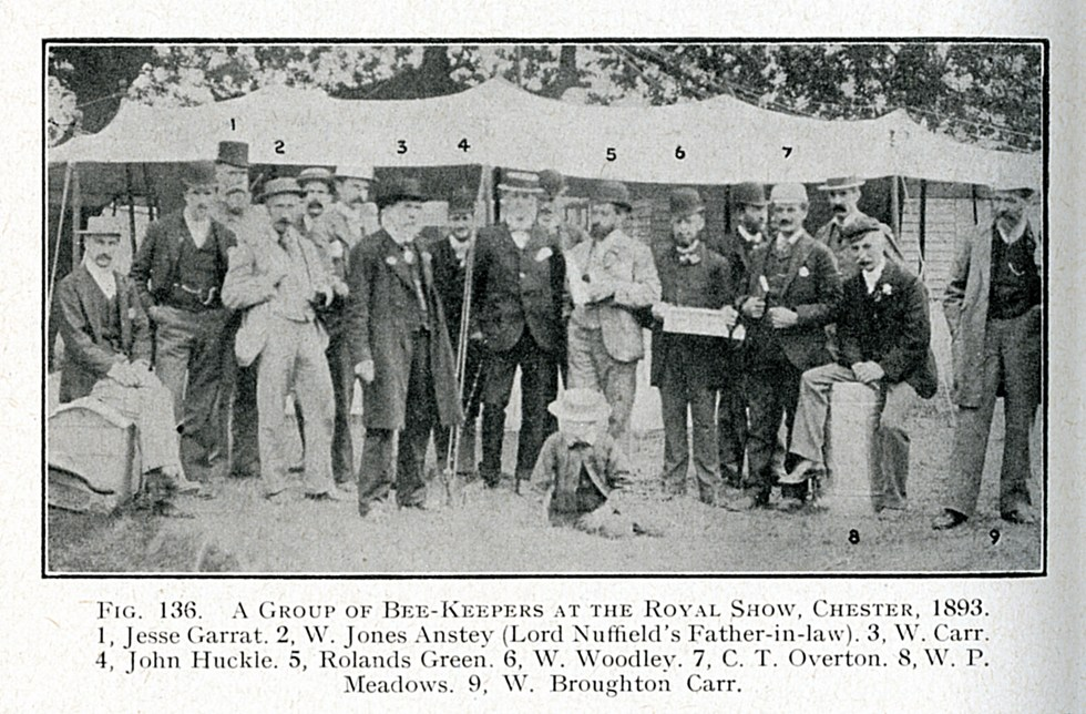 William Woodley with fellow competitors at the Royal Show, Chester in 1893. William Woodley is holding his winning frame of honeycomb. In the photograph is the famous William Broughton Car who invented the WBC hive. #WilliamWoodley, #Beedon,