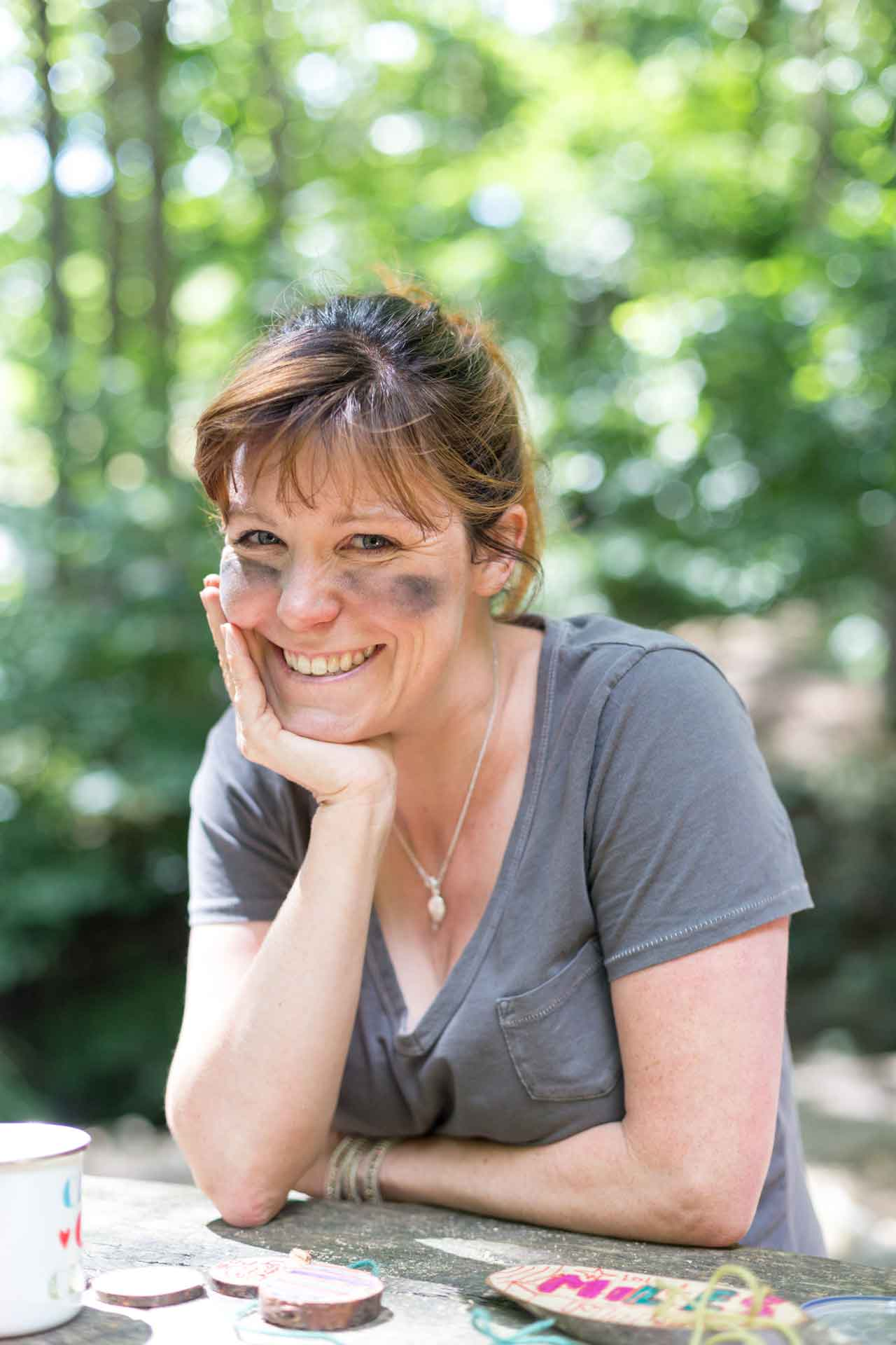A photo of Lucy Collins, Bee in the Woods founder.