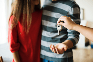couple receiving keys to first home