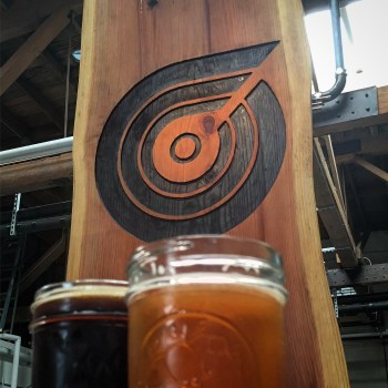 Massive planks of live edge redwood make up the bar.