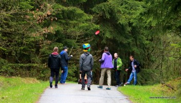 hikers with frisbee on trail