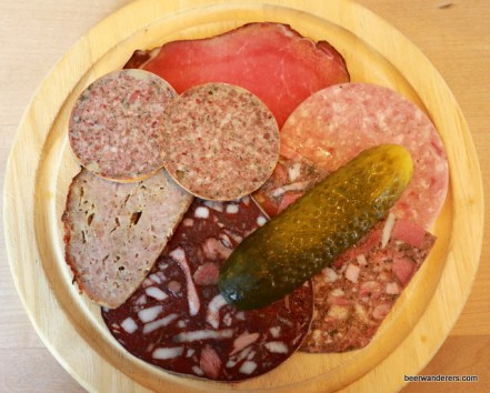 mixed meats with a pickle