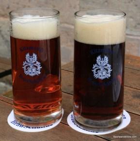 amber and dark beers in mugs