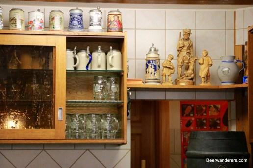 cozy pub with old ceramic mugs