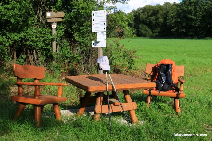 picknic table with backpack