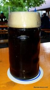 dark beer in mug with head