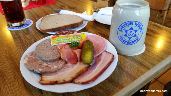 cold cuts on plate with beer