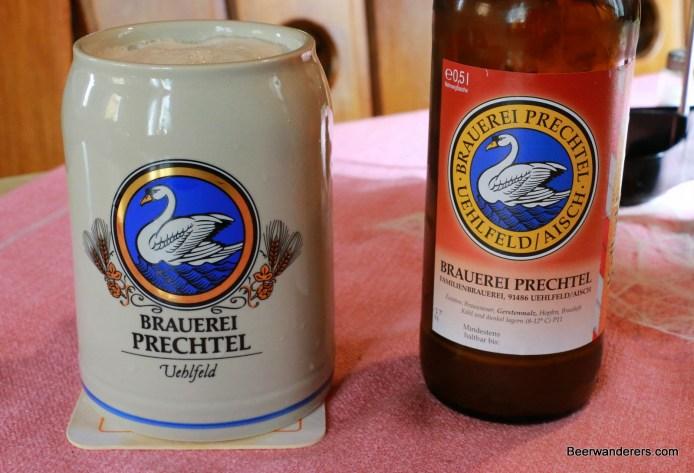 beer in ceramic mug with bottle