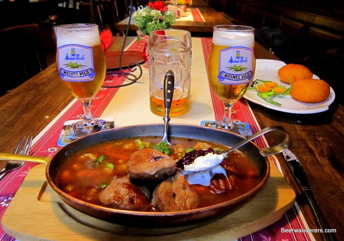 meat in serving pan with beer