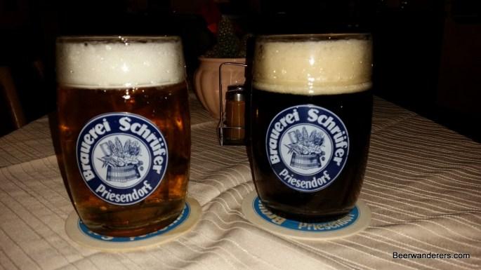 light ad dark beers in mugs