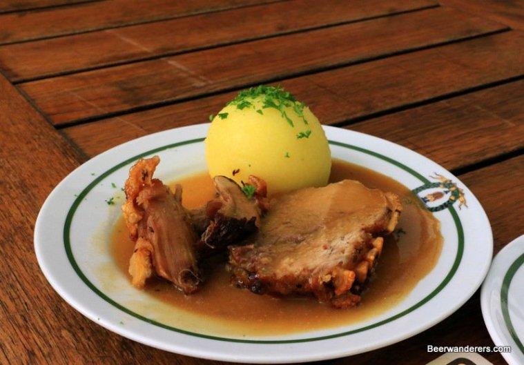 crispy roast port with dumpling in sauce