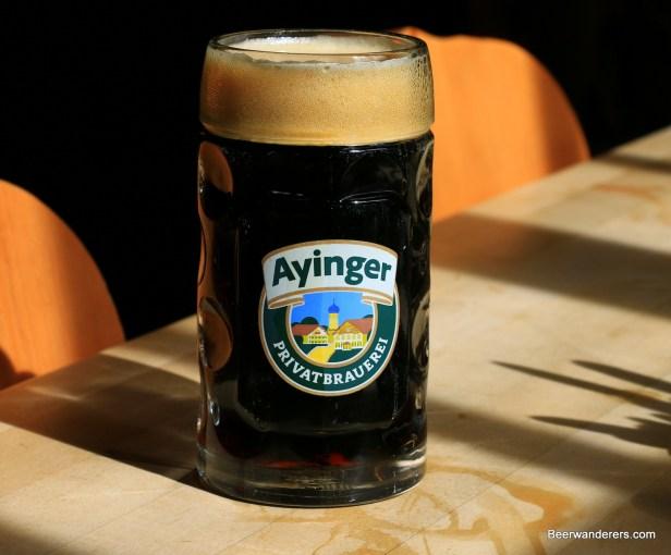 dark beer in mug with big tan head