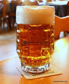 dark golden beer in mug with big head