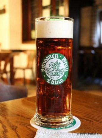 brown beer in mug