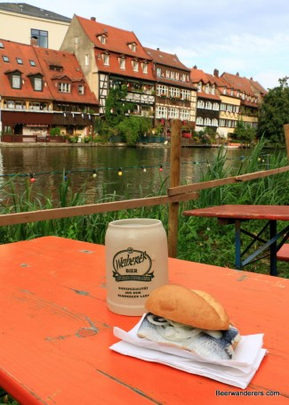 fish sandwich with beer on river