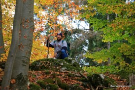 hiker on hill in fall