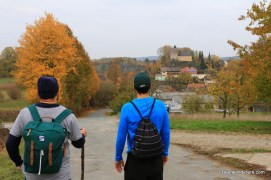 beer hikers on trail to castle