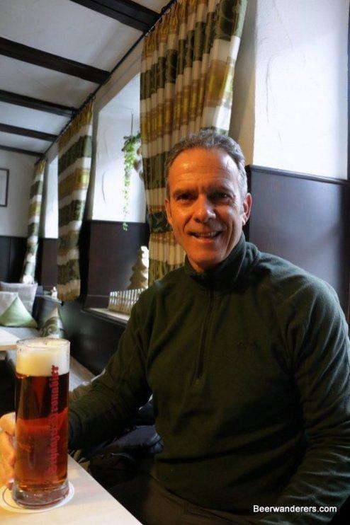man enjoying beer