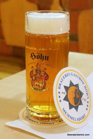 golden beer in mug with coaster