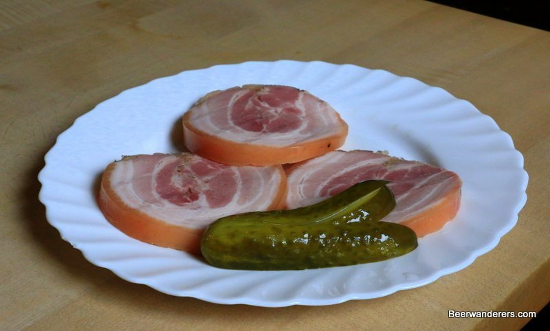 thick slices of pork with a pickel