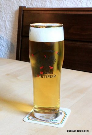 pale yellow beer in tall glass