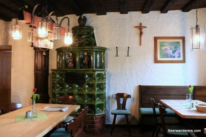 pub interior with green tile oven
