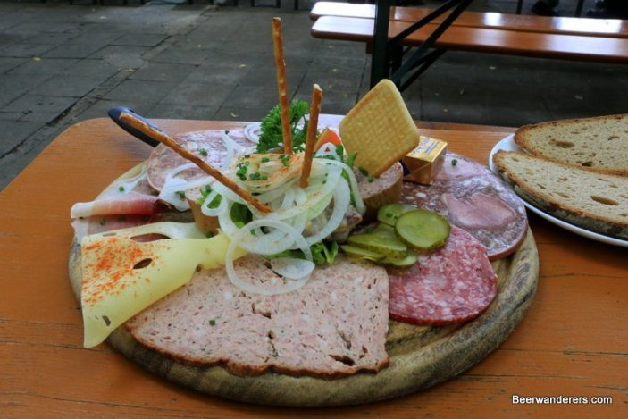 cold cuts on wooden plate