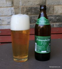 beer in glass with bottle