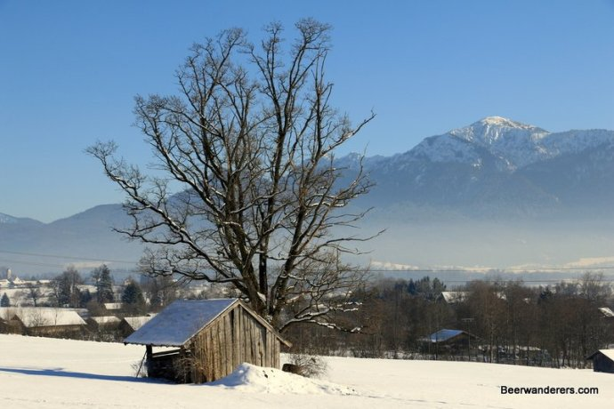 hut in snow with mountains