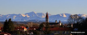 town with alps in back