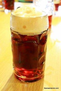 amber beer in mug with big head